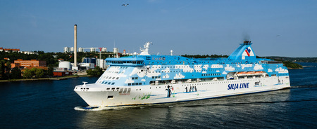 Stockholm, Sweden - July 7, 2013: Galaxy cruise ship leaving the Port of Stockholm Editorial