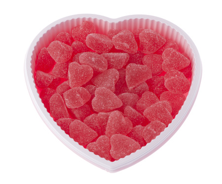 Valentiness day, birthday heart shaped box filled with red strawberry hearts, isolated on white background.