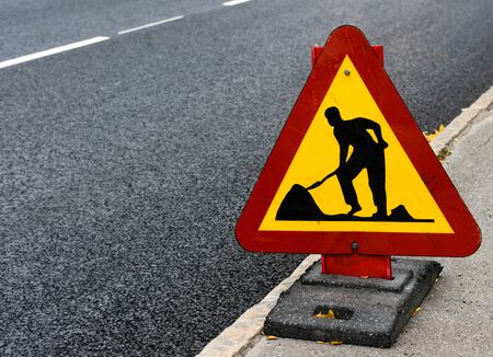 Roadwork sign at the side of a road in Sweden