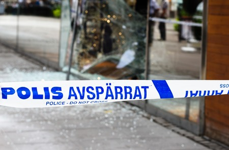Sodertalje, Sweden - 4 August 2016: Crime scene investigation police do not cross boundary tape investigating police team, a store has been burglaries Stock Photo - 66994633