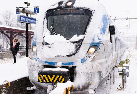Stockholm, Sweden - November 9, 2016: Snowy local train has arrived at its final destination on a winter day