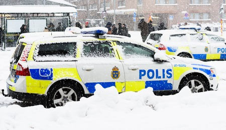 Stockholm, Sweden - November 9, 2016: Swedish Police cars parked a winter day when it is snowing outside the main train station, Stockholms centralstation 에디토리얼