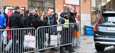 Stockholm, Sweden - December 10, 2016: Swedish police  closes gate to Stockholm Concert Hall, Hotorget at the Nobel Prize Award Ceremony, people passing are trying to get a glimpse of Nobel Laureates 에디토리얼