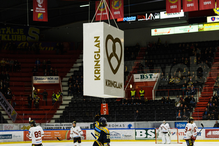 Sodertalje, Sweden - January 15, 2017: Mans Lindback, SSK scores the first goal in Ice hockey match and got a prize for that, in hockeyallsvenskan between SSK and MODO in the sports complex Scaniarinken