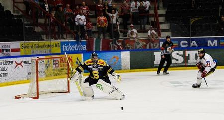 Sodertalje, Sweden - January 15, 2017: Jordan Smotherman, MODO try to score goal in the Ice hockey match in hockeyallsvenskan between SSK and MODO in the sports complex Scaniarinken