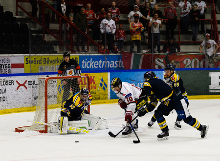 Sodertalje, Sweden - January 15, 2017: Per-Ake Skroder, MODO try to score goal in the Ice hockey match in hockeyallsvenskan between SSK and MODO in the sports complex Scaniarinken Stock Photo - 72818591