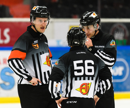 Sodertalje, Sweden - January 15, 2017:  hockey referees discussing something in the game in the Ice hockey match in hockeyallsvenskan between SSK and MODO in the sports complex Scaniarinken