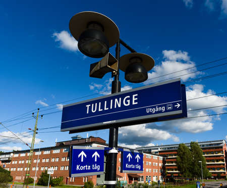 Tullinge, Sweden - August 12, 2015: Tullinge train station with the station sign, speaker, sign show exit direction to bus, also sign for short train