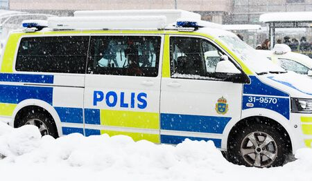 Stockholm, Sweden - November 9, 2016: Swedish Police cars parked a winter day when it is snowing outside the main train station, Stockholm central station