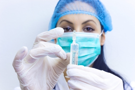 sciences: Young doctor prepares an injection, photography Stock Photo