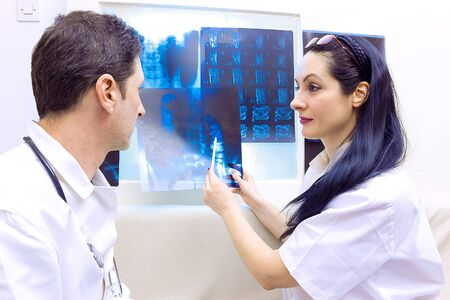 Doctors are viewing X-rays, photography photo