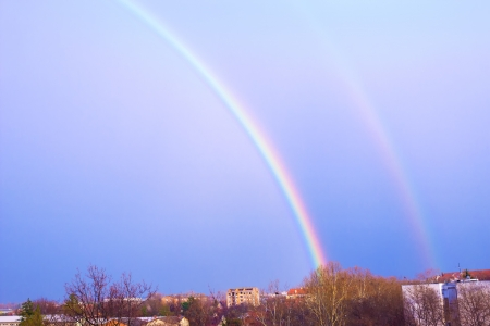 atmospheric pressure: Two beautiful rainbows over the city,photography