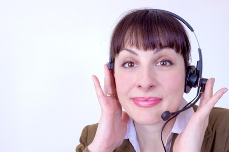 Beautiful young woman working in a telephone customer service, photography photo