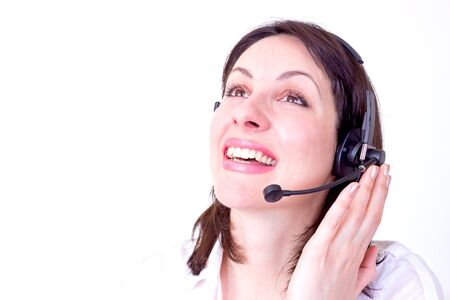 Beautiful young woman working in a telephone customer service  photo