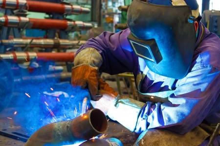 metal worker: Welder weld metal ,photography Stock Photo