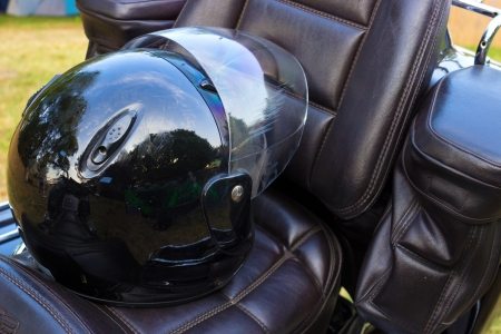 helmet seat: Black helmet on a leather seat motors