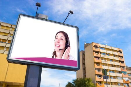 bordeau:  Large billboard with a picture of a beautiful smiling woman with a cordless phone and a blank space for advertisement, photography