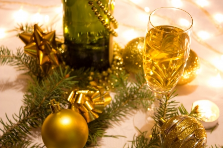 Beautiful ornaments, candles and champagne as a New Year decoration, photography photo