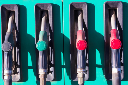 refills: At the gas station ; Automate for refills fuel along with nozzles,photography Stock Photo