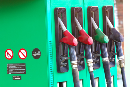 refills: Petrol pump ; Automate for refills fuel along with nozzles,photography