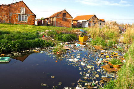 Settlement through which the river that is polluted with various garbage, Polluted rivers, photography