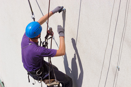 Height works ; Specially equipped worker performs height work,photography