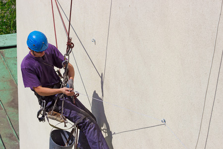 fall arrest: Work at height ; Specially equipped worker performs height work,photography