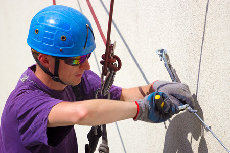 human height: Worker at height ; Specially equipped worker performs height work,photography