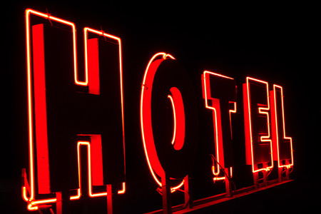 hotel rooms: Light advertisement for Hotel ; Illuminated advertising for the hotel is flashing in the night sky