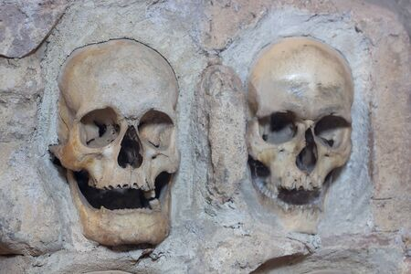 Human skulls in stone ; Nisch,Serbia,07.09.2015.Monument from the First Serbian Uprising 1809. which was in retaliation by the Turkish authorities in Serbia built from the skulls of dead Serbian warriors