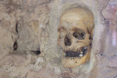 retaliation: Human skull  ; Nisch,Serbia,07.09.2015.Monument from the First Serbian Uprising 1809. which was in retaliation by the Turkish authorities in Serbia built from the skulls of dead Serbian warriors