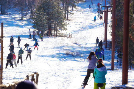 skiers: Season of winter sports ; Skiers are riding a ski lift on the mountain top
