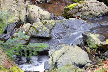 purl: Clean mountain stream ; Beautiful waterfall from mountain rivers overflowed cast down the rocky scenery Stock Photo