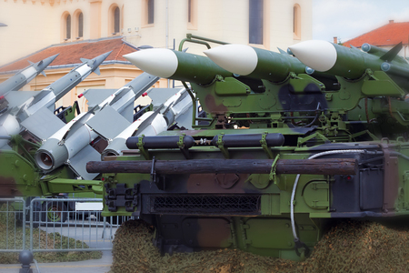 weapon: Guided missile on launch ramp ; Launching ramp with military missile systems to defend against attacks from the air.Medium-range Rocket system Stock Photo