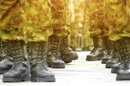 general practice: Army Military Boots ; Lines  of commando soldiers in camouflage uniforms Stock Photo