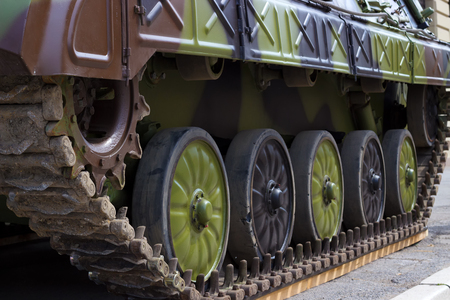 archival: Military Tank track ; Military Tank track of camouflage colors Armored Tank Stock Photo