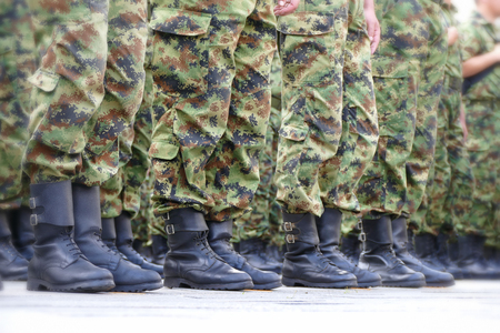 commando: Lines  of commando soldiers ; Lines  of commando soldiers in camouflage uniforms