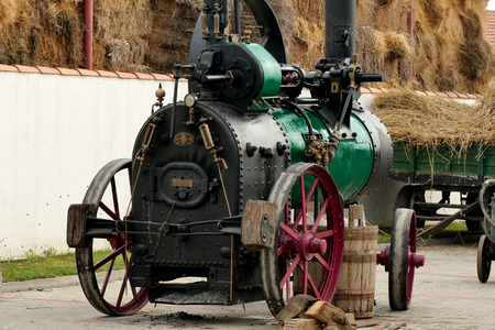 Novo Milosevo;Serbia ; 10.09.2016.Steam engine and grain thresher exhibited at the Museum of Agriculture-