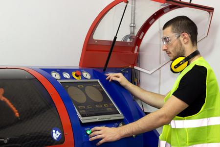 Machine operator works for the machine