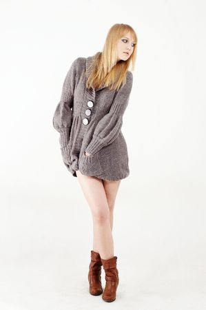A fashion woman wearing a grey jumper and brown boots Stock Photo - 5531999