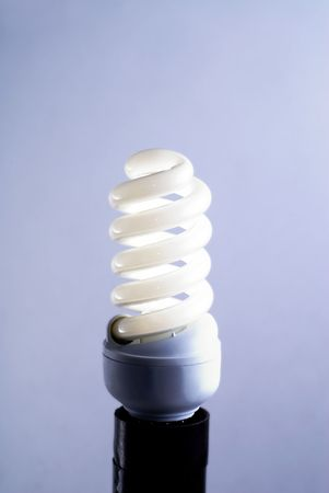 a bulb on light blue background photo