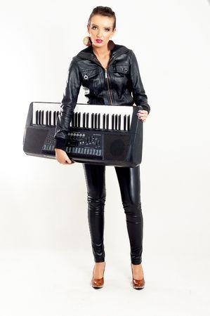 punk rock fashion girl holding a piano keyboard Stock Photo - 6048799