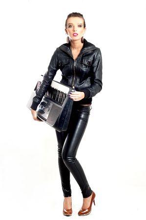 punk rock fashion girl holding a piano keyboard Stock Photo