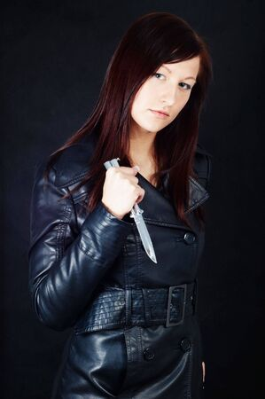 Woman in black holding a knife photo