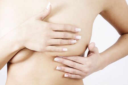 checking breats for signs of breast cancer Stockfoto