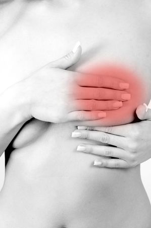 checking breats for signs of breast cancer Stock Photo