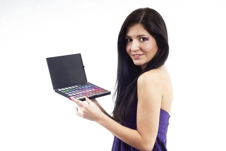 a nice woman holding an eyeshadow set photo