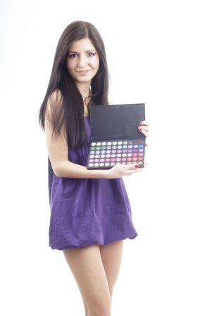 a nice woman holding an eyeshadow set photo
