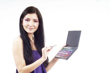een mooi vrouw een eyeshadow bedrijf instellen