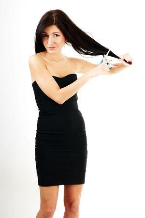 haircutting: nice woman cutting her long dark hair Stock Photo